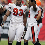 Tampa Bay Buccaneers defensive tackle Gerald McCoy (93) and Sean Jones (26) celebrate after the team defeated the Cleveland Browns 17-14 during an NFL football game Sunday, Sept. 12, 2010, i …