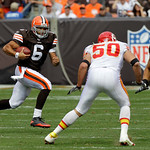 Cleveland Browns quarterback Seneca Wallace (6) runs the ball as running back Peyton Hillis blocks Kansas City Chiefs linebacker Mike Vrabel (50) in the third quarter of an NFL football game …