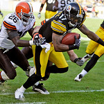 Pittsburgh Steelers receiver Mike Wallace (17) fights for yardage on a 21-yard reverse play to the two-yard line against Cleveland Browns' Abram Elam (26) in the fourth quarter of an NFL foo …