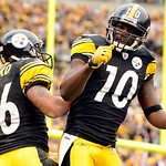 Pittsburgh Steelers wide receiver Hines Ward (86) and teammate Santonio Holmes celebrate after Ward's 56-yard touchdown against the Cleveland Browns during the second quarter of an NFL footb …