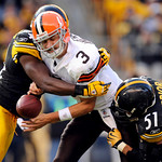 Pittsburgh Steelers linebackers Lawrence Timmons, left,and James Farrior (51) sack Cleveland Browns quarterback Derek Anderson (3), causing a fumble, during the third quarter of an NFL footb …