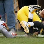 Pittsburgh Steelers wide receiver Hines Ward, right, grabs the ball in the end zone behind Cleveland Browns defensive back Mike Adams in the second quarter of an NFL football game in Pittsbu …