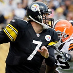 Pittsburgh Steelers quarterback Ben Roethlisberger (7) is chased out of the pocket by Cleveland Browns' Corey Williams, right, during the first quarter of an NFL football game in Pittsburgh, …