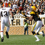Pittsburgh Steelers wide receiver Mike Wallace, right, makes a catch ahead of Cleveland Browns safety T.J. Ward for a 50-yard reception that helped set up a Steelers touchdown in the third q …