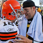 Pittsburgh Steelers quarterback Ben Roethlisberger, right, visits with Cleveland Browns quarterback Colt McCoy (12) after a 28-10 Steelers win in an NFL football game in Pittsburgh, Sunday,  …