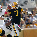 Pittsburgh Steelers quarterback Ben Roethlisberger (7) gets rid of the ball as he is hit by Cleveland Browns defensive tackle Shaun Rogers (92) in the second quarter of an NFL football game  …