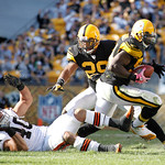 Pittsburgh Steelers linebacker Lawrence Timmons, right, runs after making an interception of a pass intended for Cleveland Browns running back Peyton Hillis (40) in the fourth quarter of an  …