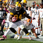 Pittsburgh Steelers linebacker Lawrence Timmons (94) steps on the out-of-bounds line as he returns an interception as Cleveland Browns center Alex Mack (55) pursues in the fourth quarter of  …