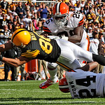 Pittsburgh Steelers receiver Hines Ward leaps into the end zone between Cleveland Browns defenders Abram Elam (26) and Sheldon Brown (24) for a touchdown during the third quarter of an NFL f …