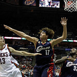 Milwaukee Bucks' Luke Ridnour (13) tries to shoot over Cleveland Cavaliers' Anderson Varejao (17)- and Shaquille O'Neal (33) during the second half of an NBA basketball game Sunday, Dec. 6,  …