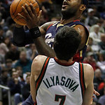 Milwaukee Bucks' Ersan Ilyasova (7) is called for a foul as Cleveland Cavaliers' LeBron James goes up for a shot during the first half of an NBA basketball game Sunday, Dec. 6, 2009, in Milw …