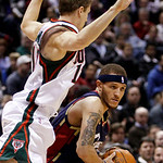 Cleveland Cavaliers' Delonte West drives past Milwaukee Bucks' Luke Ridnour during the first half of an NBA basketball game Sunday, Dec. 6, 2009, in Milwaukee. (AP Photo/Morry Gash)