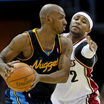 Cleveland Cavaliers guard Mo Williams, right, puts pressure on Denver Nuggets guard Chauncey Billups in the fourth quarter in an NBA basketball game Thursday, Feb. 18, 2010, in Cleveland. Th …