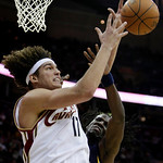 Cleveland Cavaliers' Anderson Varejao (17), of Brazil, and Memphis Grizzlies forward DeMarre Carroll (1) battle for a rebound in the fourth quarter in an NBA basketball game Tuesday, Feb. 2, …