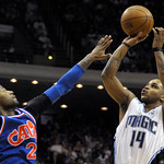 Orlando Magic guard Jameer Nelson, right, puts up a three-point basket in front of Cleveland Cavaliers guard Mo Williams during the second half of an NBA basketball game in Orlando, Fla., Su …