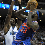 Cleveland Cavaliers forward LeBron James, right, goes up for a shot in front of Orlando Magic center Dwight Howard during the first half of an NBA basketball game in Orlando, Fla., Sunday, F …