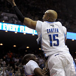 Orlando Magic guard Vince Carter, right, puts up a shot in front of Cleveland Cavaliers forward Antawn Jamison during the second half of an NBA basketball game in Orlando, Fla., Sunday, Feb. …