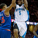 New Orleans Hornets guard Marcus Thornton (5) jumps to the basket against Cleveland Cavaliers forward Jamario Moon in the first quarter of a NBA basketball game Tuesday, Feb. 23, 2010, in Cl …