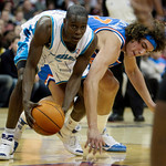 New Orleans Hornets guard Darren Collison, left, grabs a loose ball ahead of Cleveland Cavaliers forward Anderson Varejao, from Brazil, in the second quarter of an NBA basketball game Tuesda …