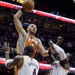 Phoenix Suns' Marcin Gortat, from Poland, (4) shoots over Cleveland Cavaliers' Antawn Jamison (4) and J.J. Hickson (21) in the second quarter in an NBA basketball game Wednesday, Jan. 19, 20 …