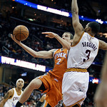 Phoenix Suns' Goran Dragic, from Slovenia, (2) drives to the basket against Cleveland Cavaliers' Ramon Sessions (3) in the second quarter in an NBA basketball game Wednesday, Jan. 19, 2011,  …