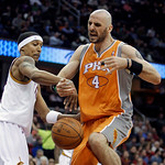 Cleveland Cavaliers' Jamario Moon, left, knocks the ball loose from Phoenix Suns' Marcin Gortat, from Poland, in the third quarter in an NBA basketball game Wednesday, Jan. 19, 2011, in Clev …