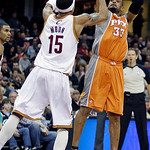 Phoenix Suns' Grant Hill (33) shoots over Cleveland Cavaliers' Jamario Moon (15) in the third quarter in an NBA basketball game Wednesday, Jan. 19, 2011, in Cleveland. Hill scored a team-hig …