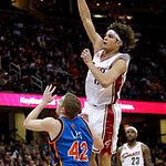Cleveland Cavaliers forward Anderson Varejao, right, from Brazil, shoots over New York Knicks center David Lee in the first quarter in an NBA basketball game Monday, March 1, 2010, in Clevel …
