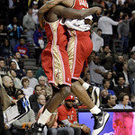Cleveland Cavaliers forward LeBron James, right, celebrates with center J.J. Hickson during the fourth quarter against the Detroit Pistons in an NBA basketball game in Auburn Hills, Mich., T …