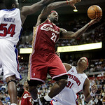 Cleveland Cavaliers forward LeBron James (23) goes to the basket between Detroit Pistons forwards Jason Maxiell (54) and Charlie Villanueva (31) in the second half of an NBA basketball game  …