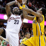 Cleveland Cavaliers' LeBron James (23) shoots over Indiana Pacers' Brandon Rush in the fourth quarter of an NBA basketball game Wednesday, March 17, 2010, in Cleveland. James scored 32 point …