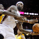 Cleveland Cavaliers' LeBron James, right, is fouled by Indiana Pacers' Roy Hibbert in the fourth quarter of an NBA basketball game Wednesday, March 17, 2010, in Cleveland. James scored 32 po …