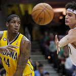 Indiana Pacers' Solomon Jones (44) flings a pass past Cleveland Cavaliers' Anderson Varejao, from Brazil, in the second quarter of an NBA basketball game Wednesday, March 17, 2010, in Clevel …