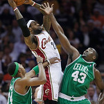 Cleveland Cavaliers' LeBron James, center, grabs a rebound between Boston Celtics' Paul Pierce, left, and Kendrick Perkins (43) in the first quarter of Game 5 of a second round NBA basketbal …