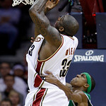 Boston Celtics' Rajon Rondo, bottom, fouls Cleveland Cavaliers' Shaquille O'Neal in the third quarter of Game 5 of a second round NBA basketball playoff series Tuesday, May 11, 2010, in Clev …