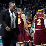Cleveland Cavaliers coach Mike Brown looks down during a timeout as players Anthony Parker (18) and Mo Williams (2) walk to the bench during the second half of Game 4 in a second-round NBA b …