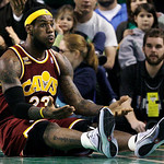 Cleveland Cavaliers forward LeBron James reacts on the floor after a play against the Boston Celtics during the first half of Game 4 in a second-round NBA basketball playoff series in Boston …