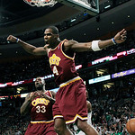 Cleveland Cavaliers forward Antawn Jamison (4) screams after dunking the ball as center Shaquille O'Neal (33) watches during the first quarter of Game 4 against the Boston Celtics in a secon …