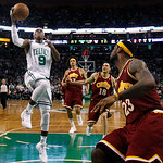 Boston Celtics guard Rajon Rondo (9) drives to the basket against Cleveland Cavaliers forward LeBron James, right, during the fourth quarter of Game 4 in a second-round NBA basketball playof …