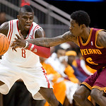 Cleveland Cavaliers guard Manny Harris (6) knocks the ball loose from Houston Rockets' guard Jermaine Taylor (8) in the second half of an NBA preseason basketball game Sunday, Oct. 10, 2010, …
