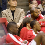 Houston Rockets center Yao Ming, left, watches his teammates during an NBA preseason basketball game against the Cleveland Cavaliers on Sunday, Oct. 10, 2010, in Houston. (AP Photo/Steve Cam …