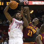 Houston Rockets forward Jordan Hill (27) grabs a rebound from Cleveland Cavaliers forward J.J. Hickson in the first half of an NBA preseason basketball game Sunday, Oct. 10, 2010, in Houston …
