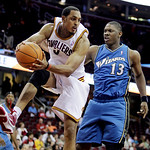 Cleveland Cavaliers center Ryan Hollins, left, grabs a rebound ahead of Washington Wizards forward Kevin Seraphin in the fourth quarter in an NBA preseason basketball game Thursday, Oct. 7,  …