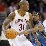 Washington Wizards forward Al Thornton knocks the ball loose from Cleveland Cavaliers forward Jawad Williams in the third quarter of an NBA preseason basketball game Thursday, Oct. 7, 2010,  …