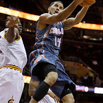 Charlotte Bobcats point guard D.J. Augustin (14) jumps toward the basket against Cleveland Cavaliers power forward Antawn Jamison in the first quarter in an NBA basketball game Tuesday, Oct. …