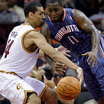 Cleveland Cavaliers guard Daniel Green, left, steals the ball away from Charlotte Bobcats point guard Sherron Collins in the fourth quarter in an NBA preseason  basketball game Tuesday, Oct. …