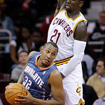 Charlotte Bobcats power forward Boris Diaw (32) tries to get past Cleveland Cavaliers power forward J.J. Hickson (21) in the second quarter in an NBA preseason basketball game Tuesday, Oct.  …