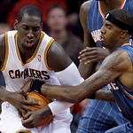Cleveland Cavaliers' J.J. Hickson and Charlotte Bobcats' Tyrus Thomas battle for the ball in the third quarter in an NBA preseason basketball game Tuesday, Oct. 5, 2010, in Cleveland. The Ca …