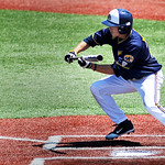 Kent State senior Jon Wilson lays down a perfect bunt and makes it to third after Akron errors. KRISTIN BAUER | CHRONICLE