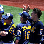 Kent State celebrates after scoring several runs on a double into center field. KRISTIN BAUER | CHRONICLE